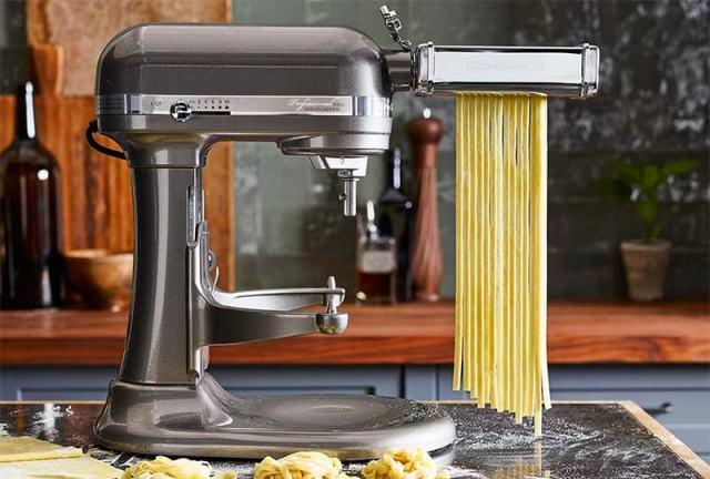 Grey KitchenAid Pasta Maker attachment making homemade fettuccine