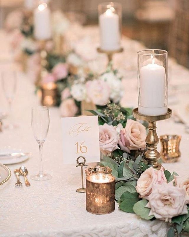 roses and greenery as wedding table runner and candles #weddingcenterpieces