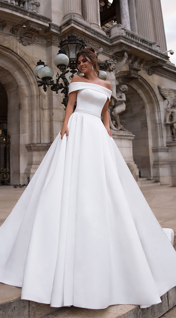 simple off the shoulder wedding dress, off-the-shoulder wedding dress, off the-shoulder beach wedding dress, off-the-shoulder wedding dresses, cold shoulder wedding dress, one shoulder wedding dress, fit and flare off the shoulder wedding dress, off shoulder fishtail wedding dress, off the shoulder sweetheart neckline, off the shoulder wedding dress