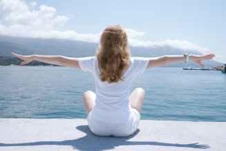 photo of woman sitting near body of water