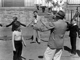 images John Ford directs a schoolyard boxing match