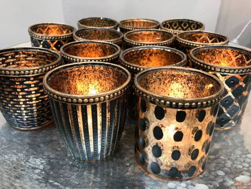 New in the gallery - lovely Indoors or out, these beautifully textured glass tea light holders create a romantic atmosphere.