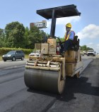 SCOOT 18-year veteran Fred Taylor with Richland Maintenance smooths out asphalt during an emergency repair on 1-26 in Columbia. SCOOT crews were quick to respond to an accident where a burning gas tanker destroyed a large section of asphalt in a high-traffic area.