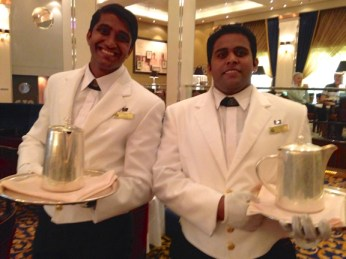 sweet guys from India serving tea