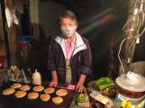 Lang the pancake lady in Pai - had some teeth problems and so is keeping her mouth masked.
