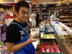 Chuan hoarding chocolate at the duty-free store.