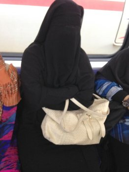 Farewell to faceless women on trains. (Nice accessorizing, though.)