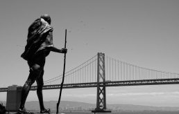Ghandi statue at embarcadero in SF with Bay Bridge in background