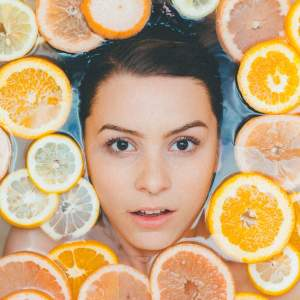 girl in water with citrus slices