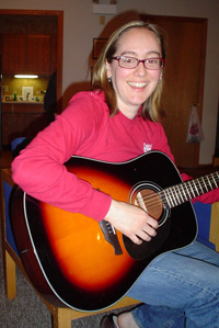 "Photo of ""Rock Star"", Amy playing guitar."