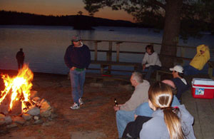 Photo of the group sitting around the campfire