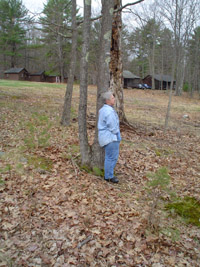 Photo of Sandra standing outside by the trees