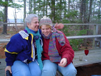 Photo of Sandra and Marcy outside, sitting on a bench
