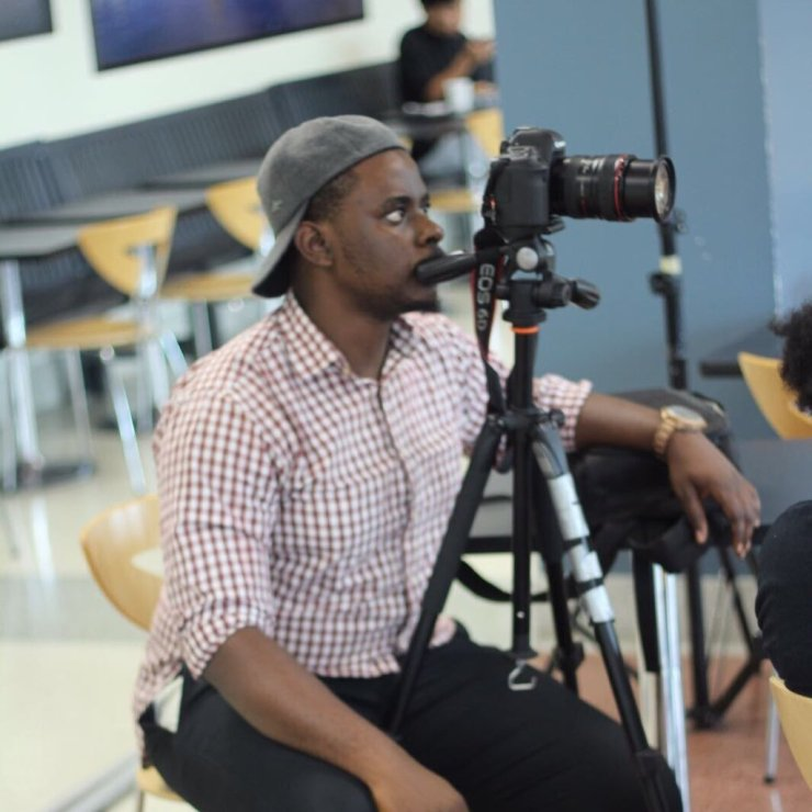 Damilola with his camera shooting a movie