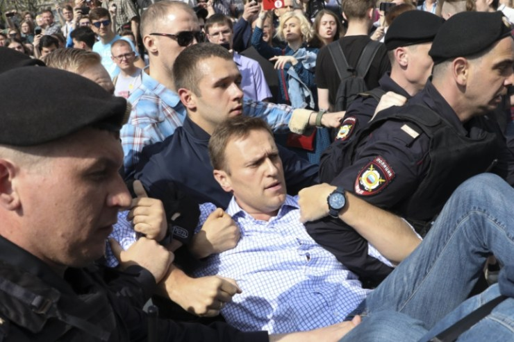 Alexei Navalny taken away by police during one of his numerous protests
