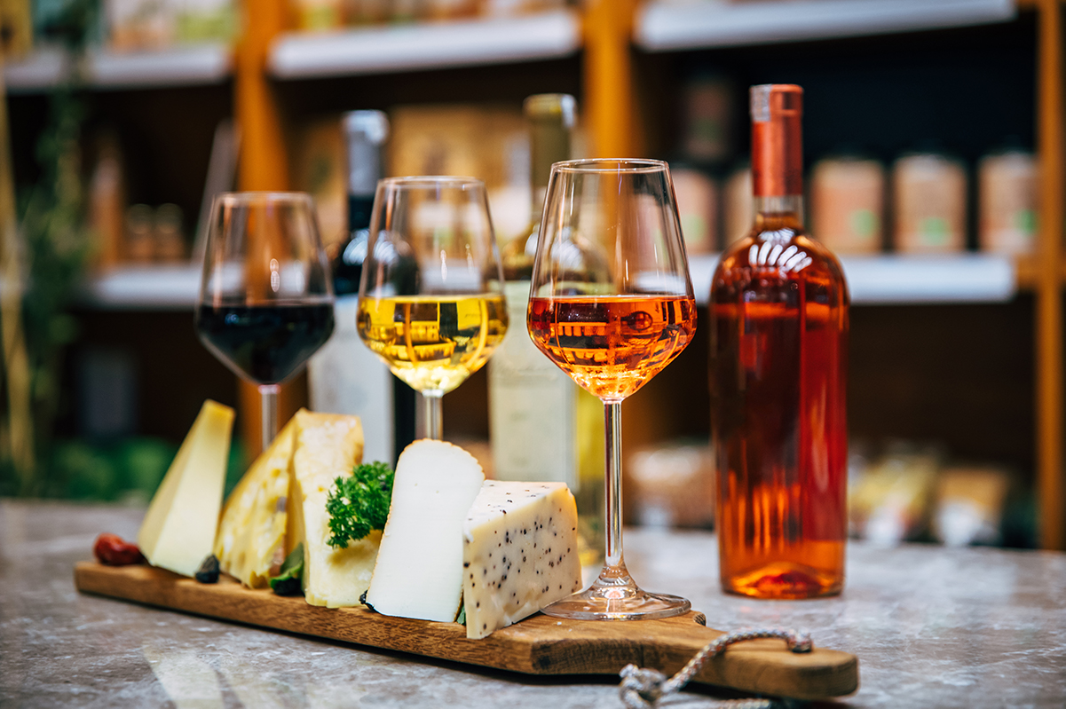 glasses of wine and cheese