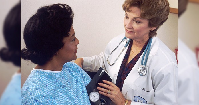 Doctor takes blood pressure