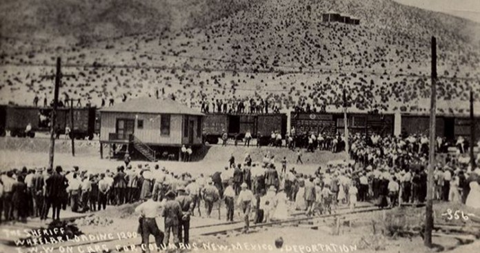 Striking miners and others being deported from Bisbee. The men are boarding the cattle cars.