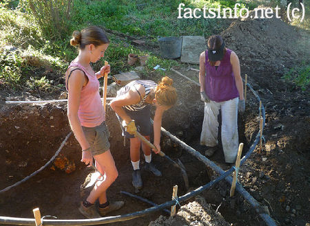 Girls digging a pond.