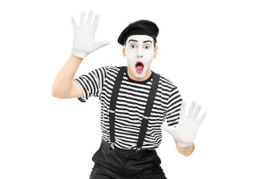 Mime with white painted face and gloves, black and white striped shirt with suspenders