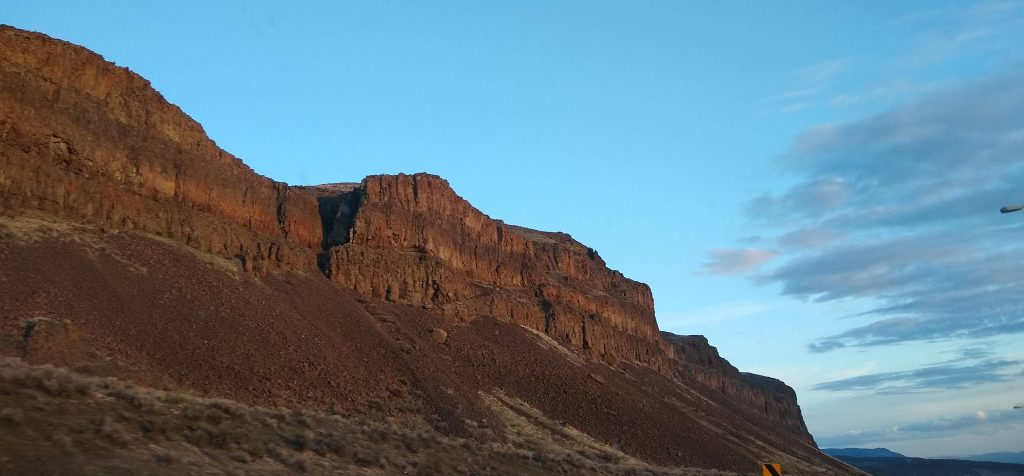 Blue sky and dark basalt flows in cliffs at Vantage, WA