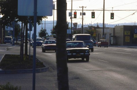 Powell Blvd., 1986. Pretty neat that you could still catch a 1957 Olds just crusing around, not in a parade.