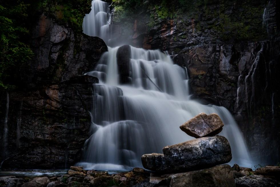 waterfall with balancing rocks
