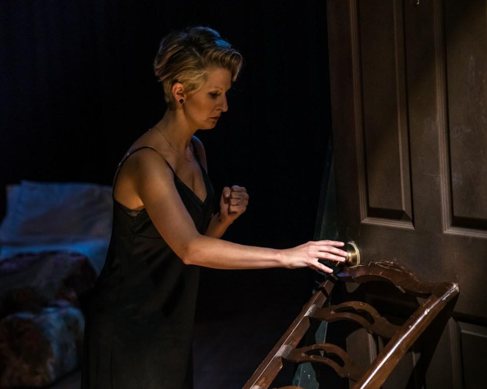 actress approaching her bedroom door in fear