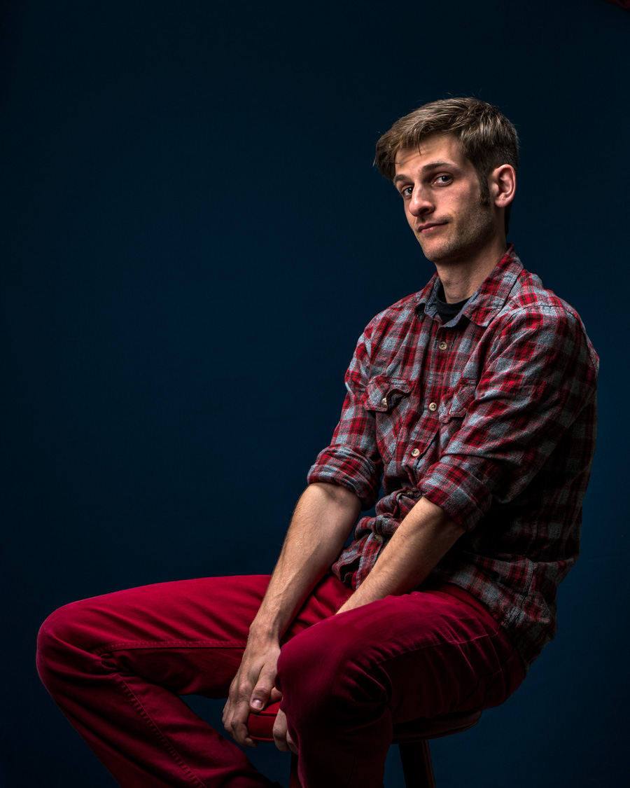 man in red pants seated