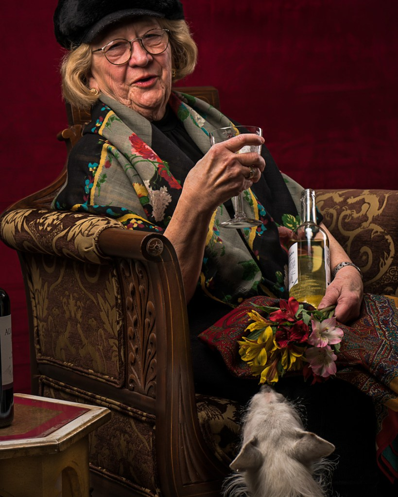 woman with wine glass and dog