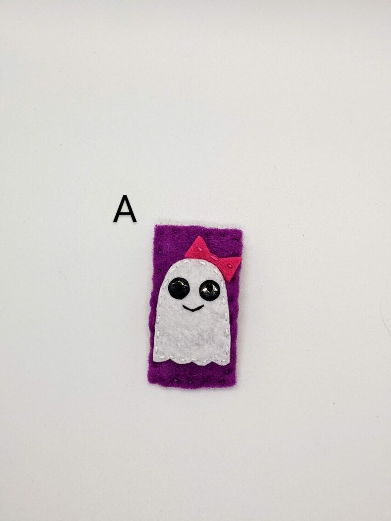 smiling ghost with bow on purple background
