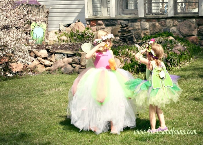 Two little girls playing outside in home made flower crowns, diy wings and diy tutus   fairy crown DIY, DIY tiara, DIY princess crow, DIY crown, fairy crowns and tiaras, fairy wreath headpiece,fairy party, children's wedding outfit, children's party,forest fairy tutu, fairy costume, tutus for girls fairy tutu diy fairy tutu, no sew tutu, no sew fairy tutu
