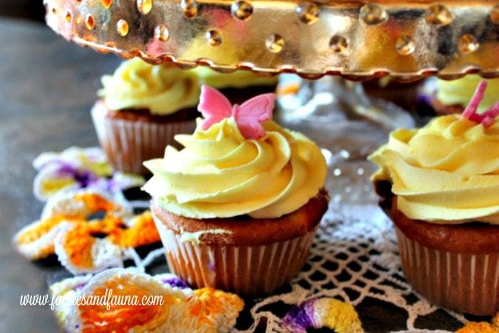 Saskatoon berry filling inside white cupcakes with lemon buttercream icing.