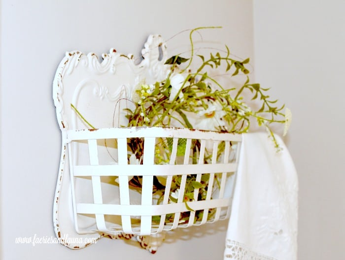 A vintage white metal basket hanging next to the DIY Farmhouse window shelf to add colour and style. DIY window shelf, DIY window rod, DIY window treatment,