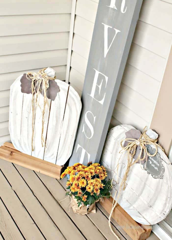 Two large neutral diy pallet pumpkins on our front porch with a DIY Harvest sign. Pumpkins, Pallet projects, pallet pumpkins, outdoor fall decor, neutral fall decor, DIY Fall Decor