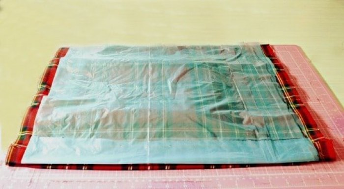 Cutting out fabric for a DIY chair cover craft.
