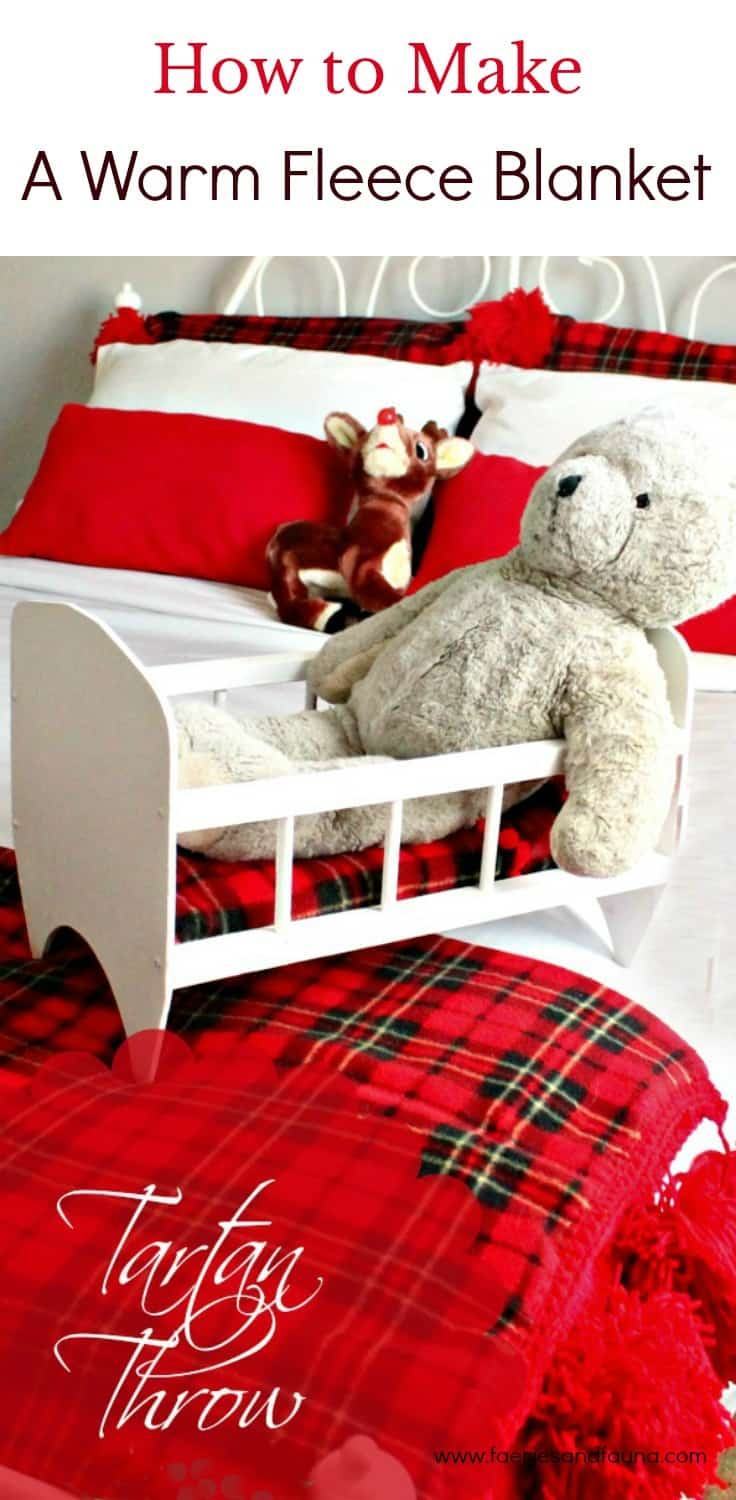 A pretty bed made up with a diy fleece blanket in red tartan for Christmas.