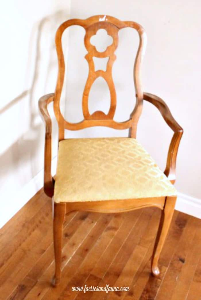 A thrift store chair in a french provincial style in need of a chair refinishing.