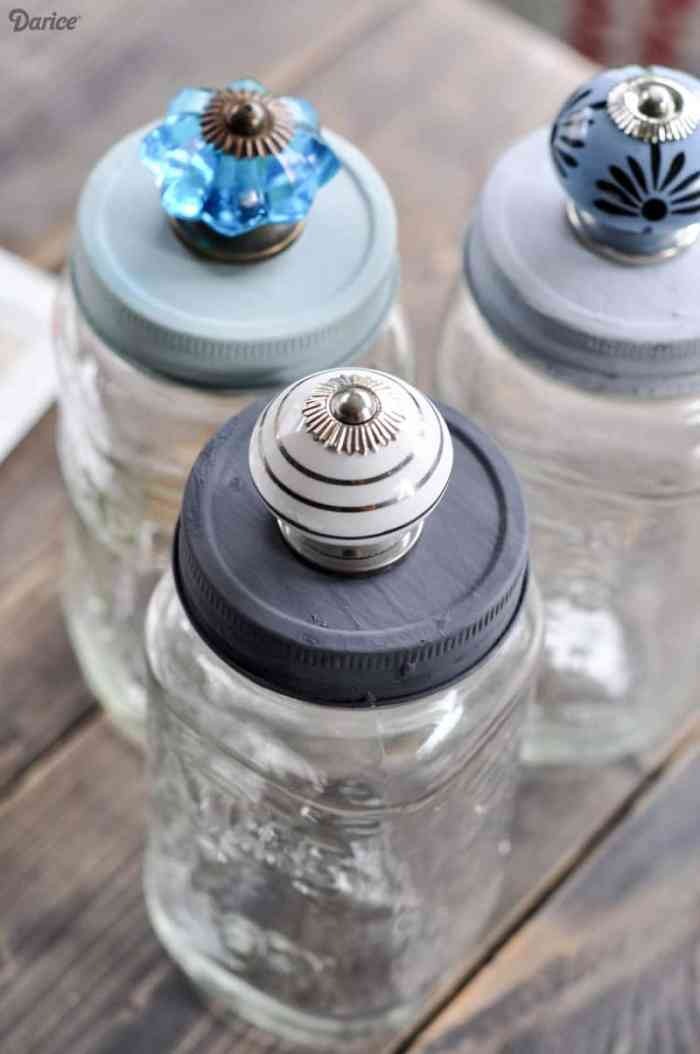 Beautiful mason jars for storage with pretty knob tops. Craft room ideas, craft room ideas on a budget, hobby room idea, sewing room idea, craft area ideas,craft room inspiration, home office craft room ideas.