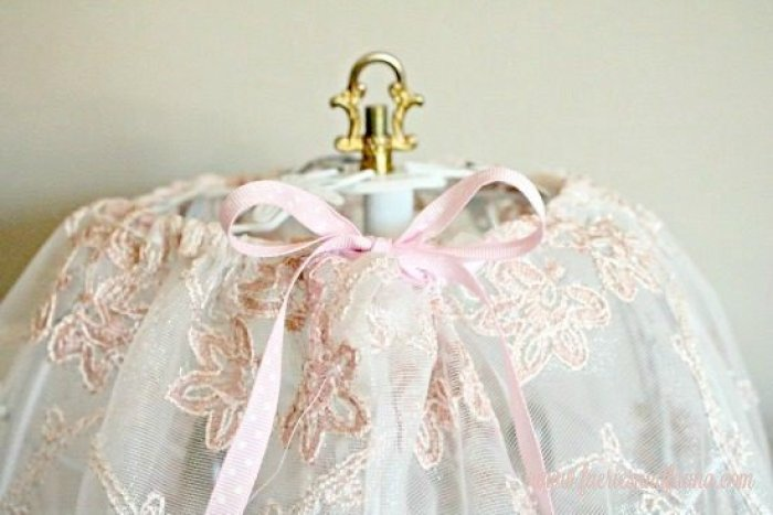 A handmade lampshade made with pink lace and ribbon on a shabby chic lamp. lamp makeover, shabby chic lampshade ideas, diy shabby chic lamp, shabby chic, shabby chic lamp