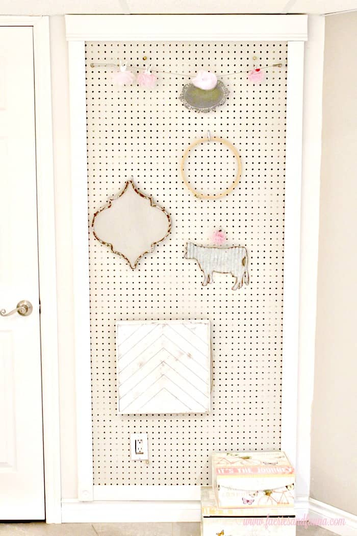 A wall sized pegboard. This pretty pegboard is a DIY pegboard and comes with a frame.