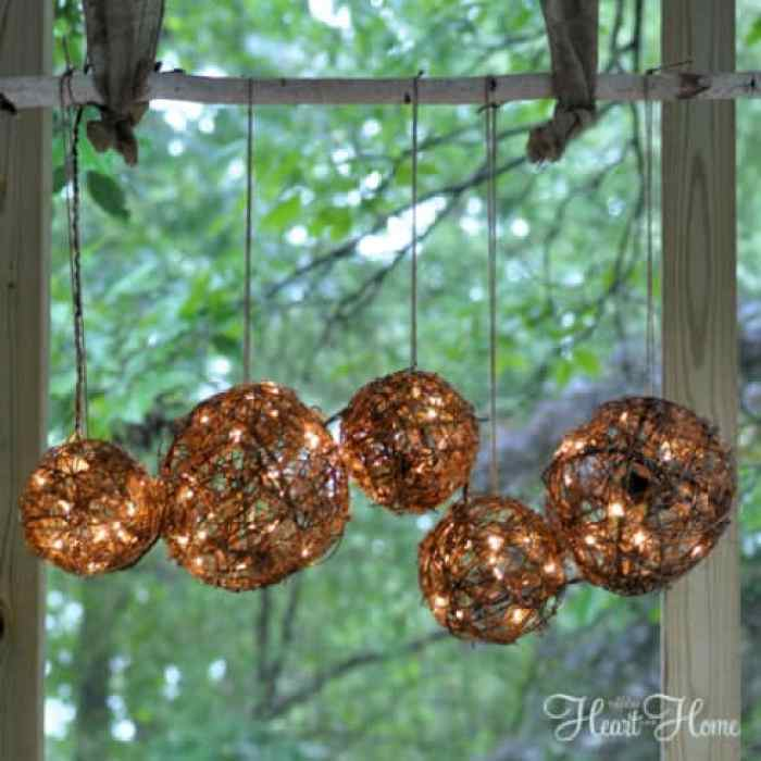 A simple rustic fall decor arrangement using miniature lights.