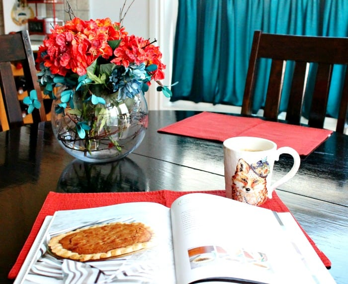 Kitchen table with fall decor, a fall centerpiece and a pumpkin pie recipe book. Fall Home Tour, fall decor ideas, DIY fall decorating,