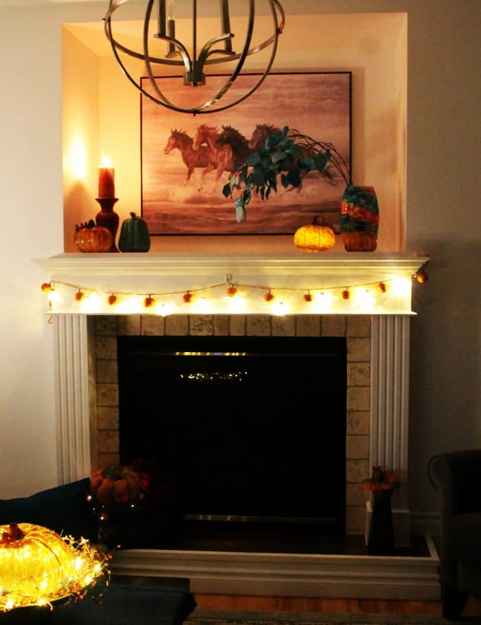A pretty fall mantel with lights. Fall Home Tour, fall decor ideas, diy fall decorating, fall home tour 2017