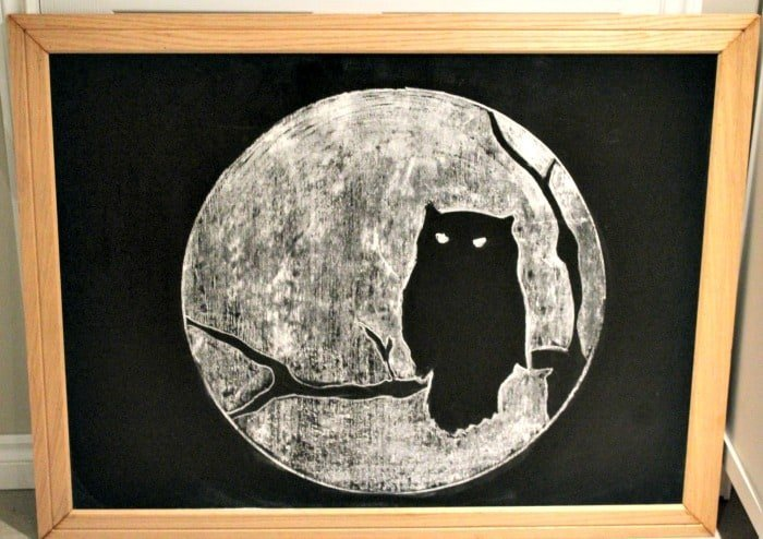 An owl against the moon chalk board art for Halloween. Cheap, and not scary Halloween decor. A decorating for Halloween art idea.