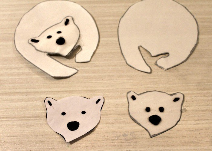 Cutting out the pieces of a DIY Christmas tree ornament of a polar bear. DIY Christmas decorations, homemade ornaments, homemade Christmas tree ornaments