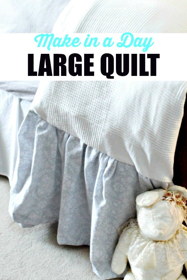 A large quilt made in a day with a pretty frill and farmhouse style.