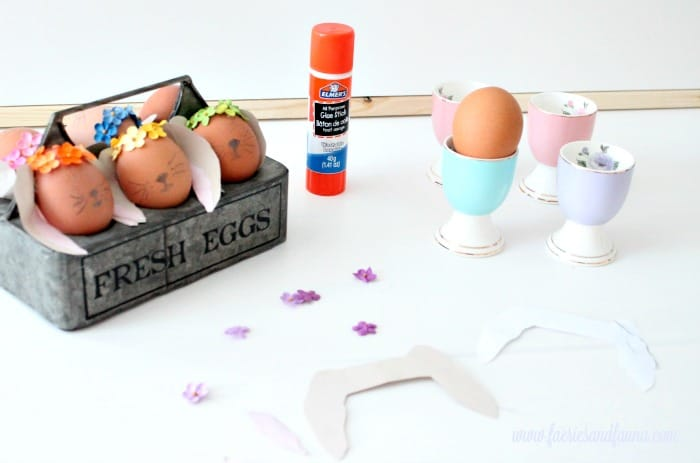 Easter egg bunny supplies including eggs, glue, small flowers. Easter Bunny Eggs, DIY Easter Eggs, how to decorate eggs, Easter egg ideas, Easter eggs, Easter egg decorating