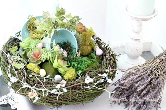 Fairy garden idea using faux moss covered rocks and a teacup,