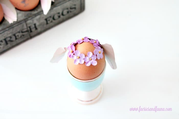 Tiny flower crown being added to the top of a Bunny Easter egg. Easter Bunny Eggs, DIY Easter Eggs, how to decorate eggs, Easter egg ideas, Easter eggs, Easter egg decorating